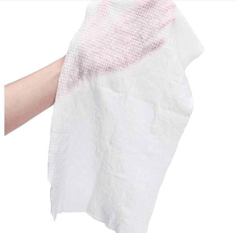 Compressed nonwoven towel